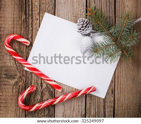 Card ,spruce branch,candy,pine cones .A letter for Christmas and New year.Copy space. selective focus. - stock photo