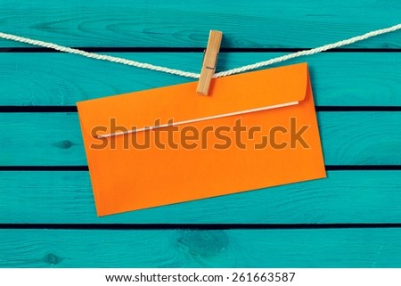 Card. text happy birthday  on the old envelope and clothes peg wood background - stock photo
