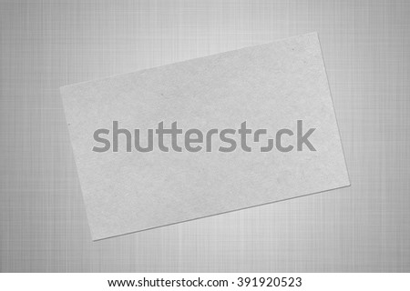 Card with cardboard texture on the gray background - stock photo
