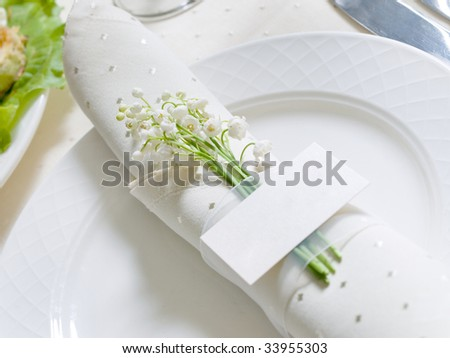 card with flowers on a banquet table - stock photo