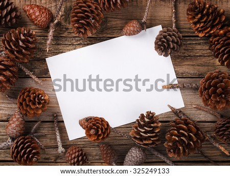 Card with pine cones .A letter for Christmas and New year.Copy space. selective focus. - stock photo
