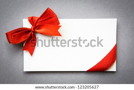 Card with red ribbons bows - stock photo