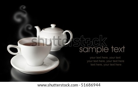 card with teapot and cup - stock photo