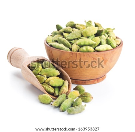 cardamom pods isolated on white background - stock photo