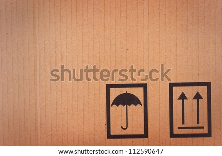 Cardboard background with shipping icons - stock photo