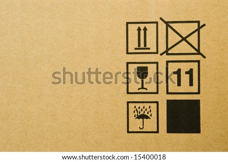 cardboard box background with mail symbols - stock photo