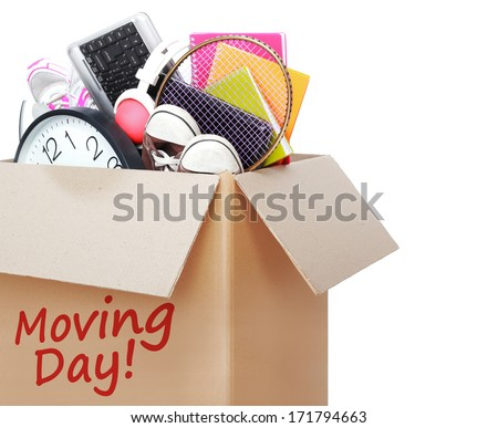 Cardboard box full of stuff marked Moving Day isolated on white background - stock photo