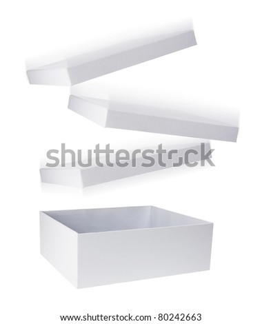Cardboard Box with Flying Lid on White Background - stock photo