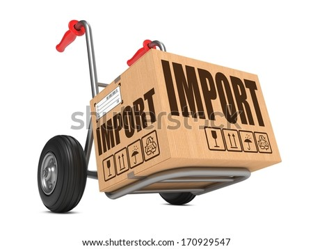 Cardboard Box with Import Slogan on Hand Truck White Background. - stock photo