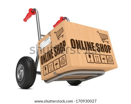 Cardboard Box with Online Shop Slogan on Hand Truck White Background. - stock photo