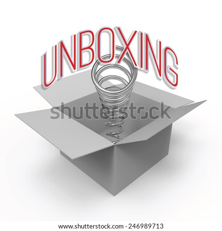 Cardboard box with spring and caption 'Unboxing'. Concept for excitement about unpacking of new product. - stock photo