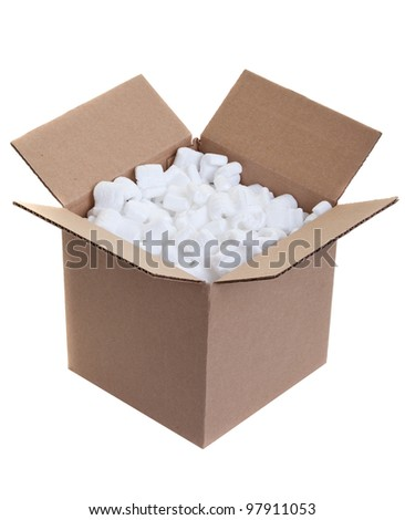 Cardboard box with styrofoam packing peanuts on white - stock photo