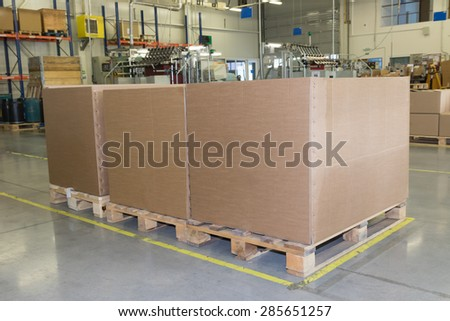Cardboard boxes are standing in a designated place in the assembly hall. The show of lean management methods. All potential trademarks are removed. - stock photo