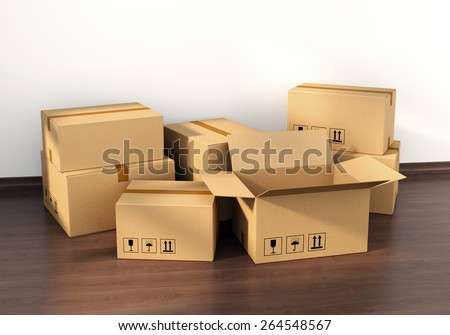 Cardboard boxes on wooden floor in new house interior. Housing, real estate and moving concept. - stock photo