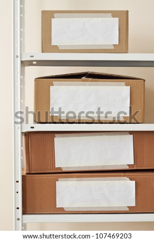 Cardboard boxes with blank labels. Moving, storage concept. - stock photo