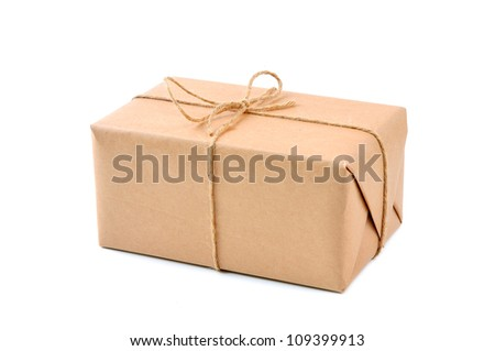 Cardboard carton wrapped with brown paper and tied with cord - stock photo