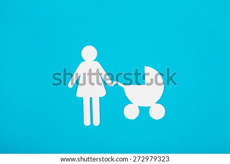 Cardboard figures of mom and child on a blue background. The symbol of unity and happiness. - stock photo