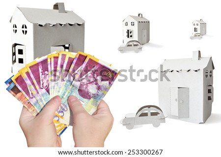 Cardboard house, automobile symbol and hands holding money (Shekels Israeli) on the white background - stock photo