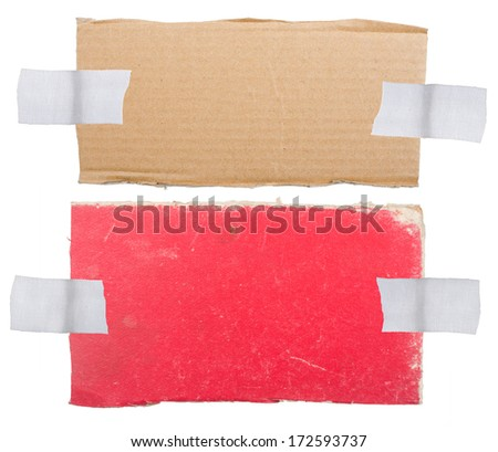Cardboard labels attached with a sticky tape - stock photo
