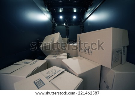 Cardboard Moving Boxes in the Large Commercial Van Cargo Area.  - stock photo