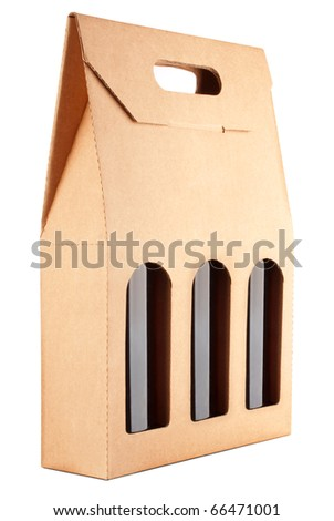 cardboard pack with three bottles of wine isolated on white background - stock photo