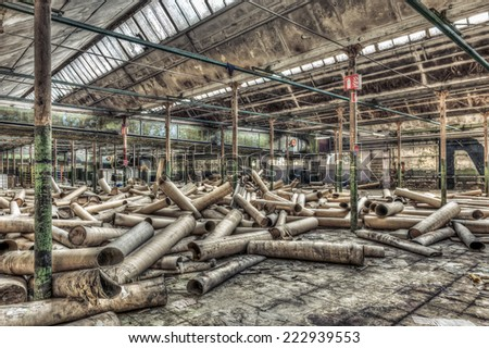 Cardboard rolls in an abandoned warehouse, HDR - stock photo