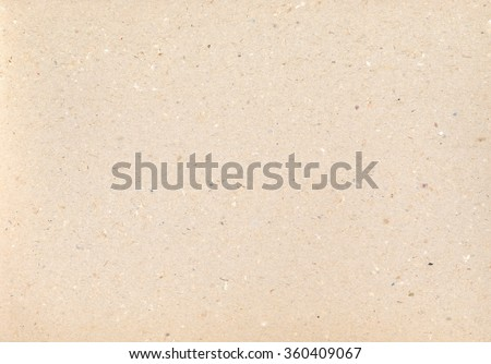 Cardboard texture. Vintage backdrop. Carton paper. Brown Grungy background. aged old macro Kraft with dots and strikes. - stock photo