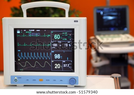 Cardiac Monitor with Vital Signs: EKG, Pulse Oximetry, Blood Pressure - stock photo