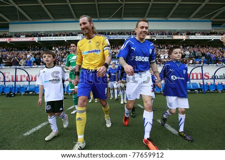 CARDIFF - APRIL 2: Craig Bellamy (right) and Robbie Savage (left) enters the stadium during a Championship match between Cardiff City FC and Derby County FC in Cardiff, April 2, 2011 in Wales, UK. - stock photo