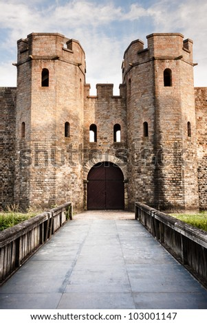 Cardiff medieval castle with bridge and blue sky - stock photo