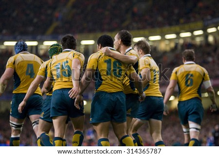 CARDIFF, WALES. 28 NOVEMBER 2009. Tatafu Polota Nau of Australia after scoring a try while playing in the International Rugby Union match between Wales and Australia - stock photo
