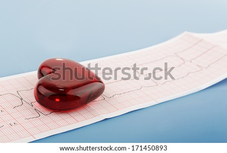 Cardiogram pulse trace and heart concept for cardiovascular medical exam, on blue medical background - stock photo