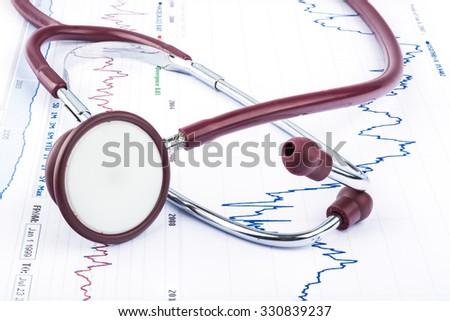 Cardiogram pulse trace and stethoscope medical exam - stock photo