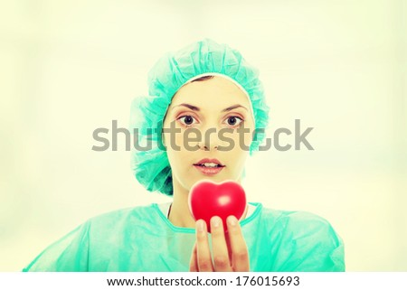 Cardiologist holding heart - stock photo