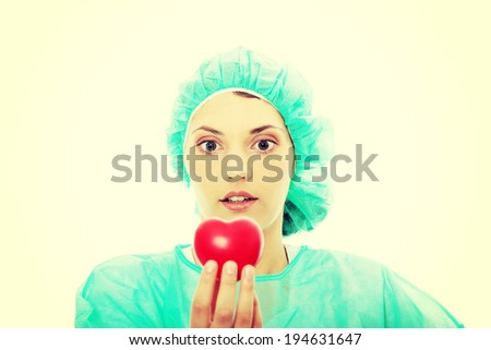 Cardiologist holding heart, isolated on white - stock photo