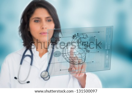 Cardiologist using a medical interface in the hospital - stock photo