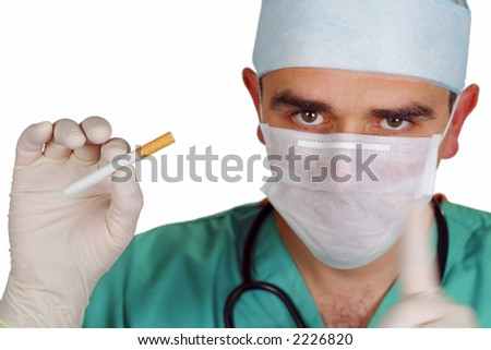 Cardivascular surgeon advising for stop smoking.The main focus on the cigarttes, the doctor a bit out of focus, intended motion blur of the left hand finger. - stock photo