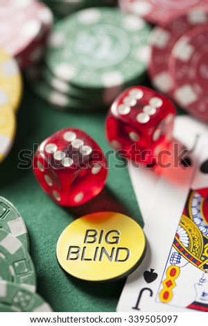 Cards and chips for poker on green table - stock photo