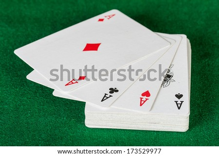 Cards and pack of playing cards on the table. - stock photo