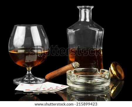 Cards, cigar and glass of whisky isolated on black - stock photo