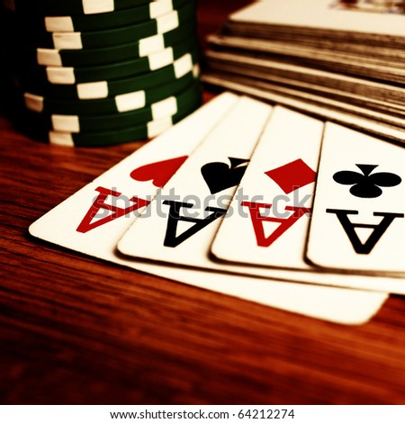 cards with chips on the table - stock photo