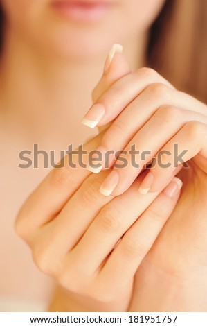 Care for beautiful woman hands. Focus on hands - stock photo