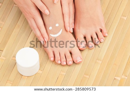 Care for beautiful woman skin. Pedicure and manicure - stock photo