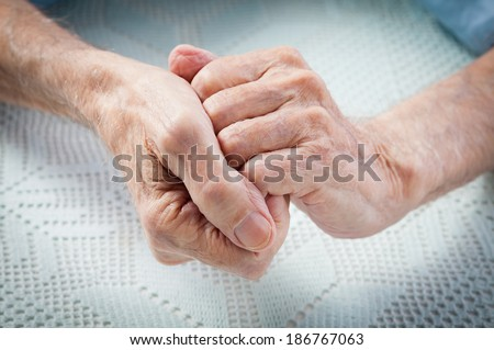 Care is at home of elderly. Old people holding hands. Closeup. Elderly man. - stock photo