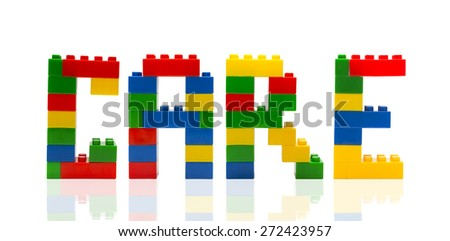 Care word build from toy building blocks. - stock photo