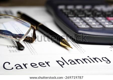 Career planning. Career opportunities management concept. Glasses pen and calculator in the background. - stock photo
