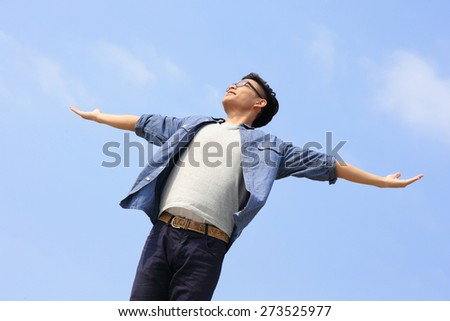 Carefree and free man raised hands and enjoy nature, asian - stock photo