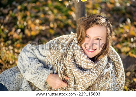 Carefree autumn woman in autumn park - stock photo