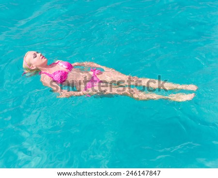 Carefree Bathing In a Blue Pool  - stock photo