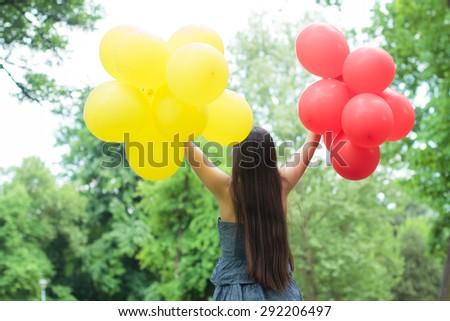 Carefree, Freedom ,Happy Lifestyle Woman with balloons enjoying nature. - stock photo